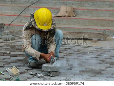 Cut, install, Brick, Bricklaying worm, Builders are laying brick Tile area. - stock photo