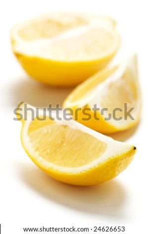 Cut lemon isolated on a white background. Background blurry.