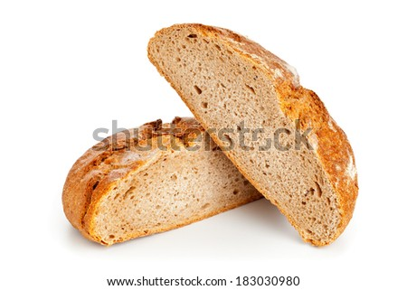 Cut loaf of fresh bread on white background - stock photo