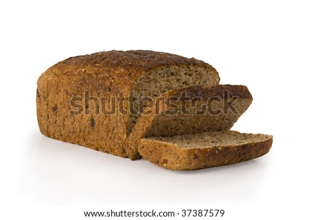Cut loaf of seed bread on white - stock photo