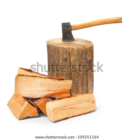 Cut logs fire wood and old axe. Renewable resource of a energy. Environmental concept. - stock photo
