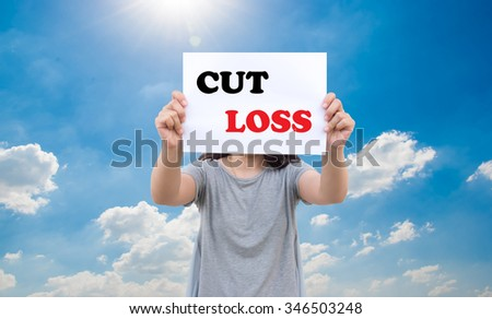 Cut loss concept of stock market by asian women show the signboard with blue sky background - stock photo