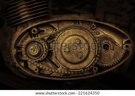 cut motor-driven chain in sepia - stock photo