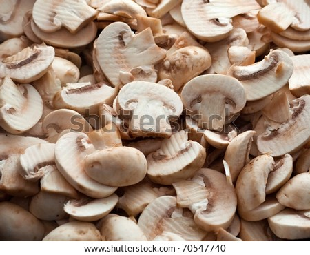 Cut mushrooms for background - stock photo