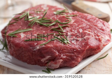Cut of raw marble beef on a cutting board - stock photo