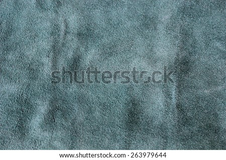 Cut of suede skin of green color for repair work - stock photo