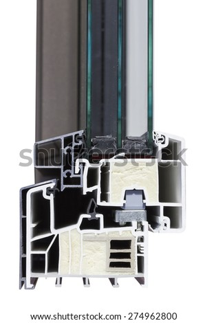 Cut of the PVC aluminium window profile with glass and insulation. Selective focus and shallow dof. - stock photo