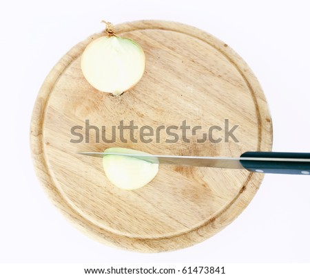 cut onion on wooden board isolated