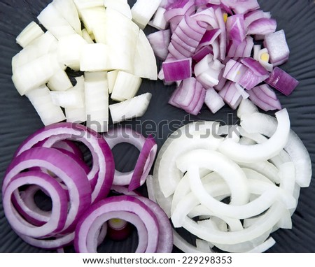Cut onions on a black plate