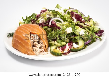Cut open smoked salmon terrine with a mixed green salad isolated on white - stock photo