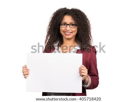 Cut out image of a young woman with brown curly hair (afro) and glasses who is holding a white empty sheet of paper.