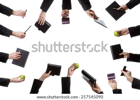 cut out of many male hands holding different objects - stock photo