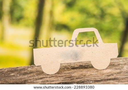 cut out paper car silhouette over forest background concept of insurance travel adventure investment - stock photo