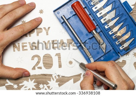 Cut out the New Year decor out of paper - stock photo
