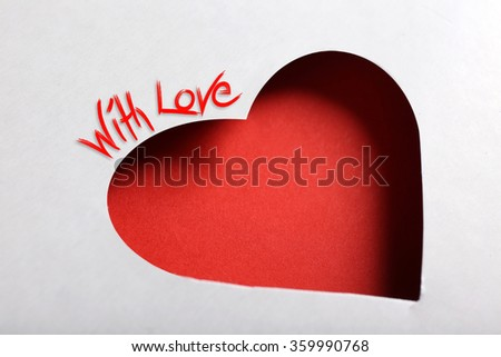 Cut out white paper heart on red background - stock photo