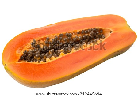 Cut papaya fruit over white background