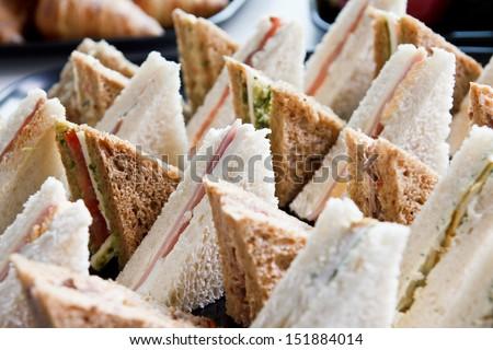 Cut platter of mixed  sandwich triangles - stock photo