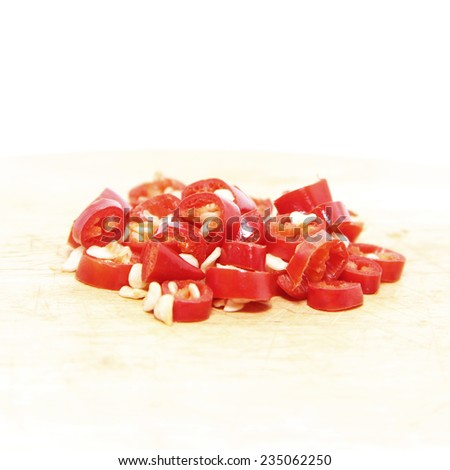 Cut red cayenne chili ingredient on white background  - stock photo