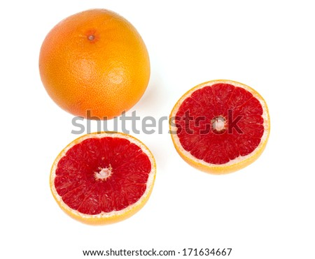 cut red grapefruit isolated on white