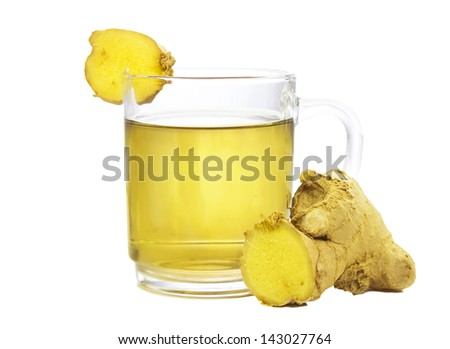 Cut rhizome of fresh root ginger, or Zingiber officinale, with a glass of fresh infusion or tea used to aid weight loss and as a treatment for dyspepsia, on a white background - stock photo