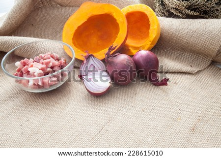 Cut the pumpkin and red onion - stock photo