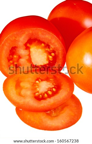 cut tomato isolated in white - stock photo