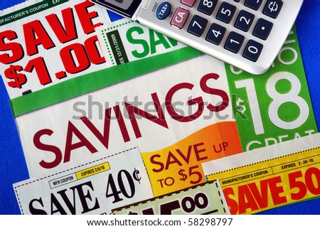 Cut up some coupons to save money - stock photo