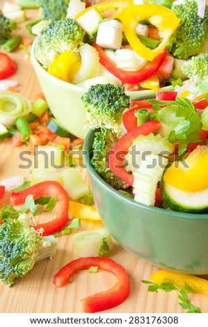 Cut vegetables in bowls - stock photo
