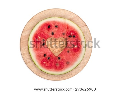 cut watermelon on wooden board isolated - stock photo