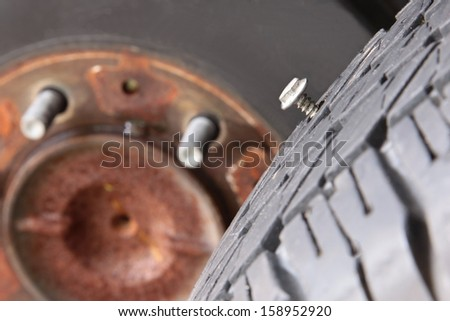 Cut wheel cause of Flat  tire on car - stock photo