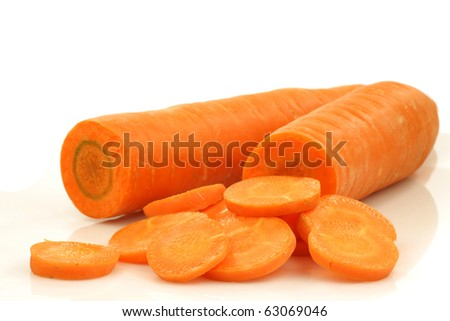 cut winter carrots on a white background