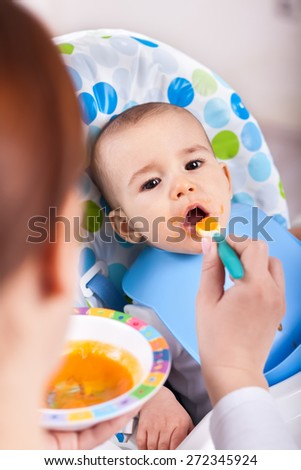 Cute adorable little kid taking a bite of food - stock photo