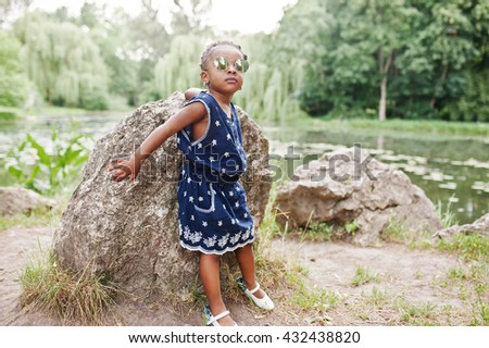 Cute african american baby girl at sunglasses - stock photo