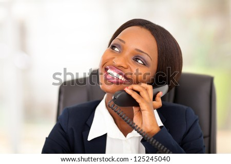 cute african american businesswoman talking on phone - stock photo