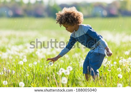 Cute african american little boy playing outdoor - Black people - stock photo