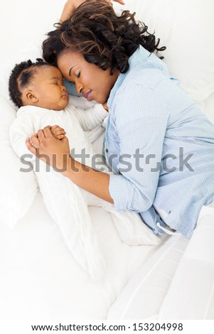 cute african american mother and her baby sleeping