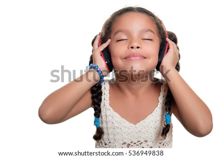 Cute african american small girl listening to music on wireless headphones - Isolated on white