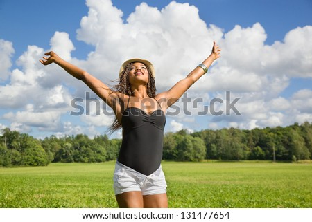 Cute African American woman hands in the air - stock photo