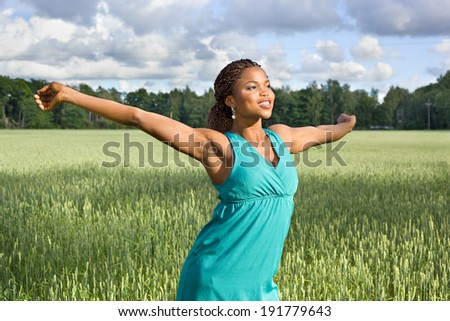 Cute African American woman smiling on a field