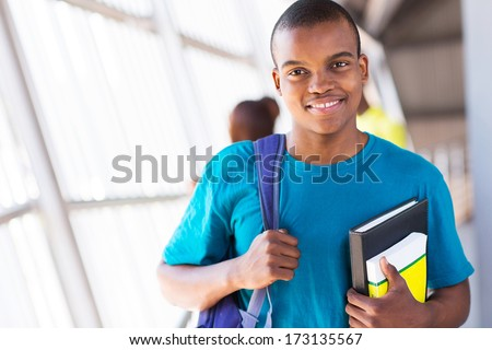 cute afro american university student looking at the camera