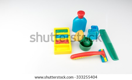 Cute and colorful plastic shaving set. Concept of hygiene education. Isolated on white background. Slightly de-focused and close-up shot. Copy space.