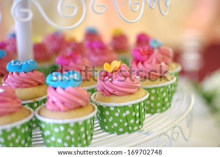 cute and colorful yummy cupcakes tier - stock photo