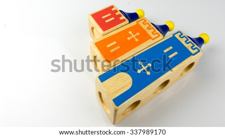 Cute and colourful wooden castle tower. Concept of building education. Isolated on white background.