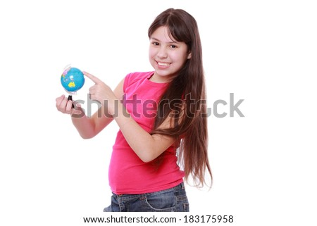 Cute and confident young preteen girl holding and show the world globe ...