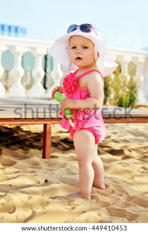 cute and fashion baby girl on the beach