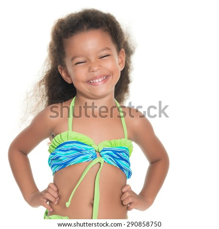 Cute and funny small african-american or hispanic girl wearing a swimsuit isolated on white - stock photo