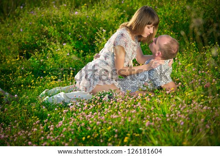 Cute and happy couple spending a romantic time together on nature - stock photo