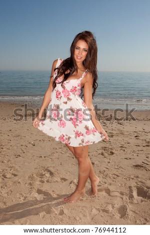 cute and sexy girl wearing dress posing near the sea - stock photo