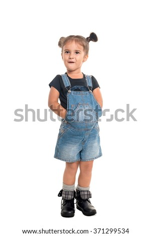 Cute and stylish baby girl  posing in studio.Isolated - stock photo