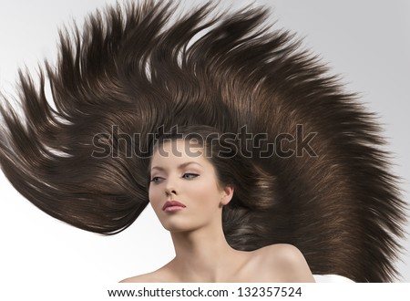 cute and young girl with hair around her and with crazy creative hairstyle - stock photo